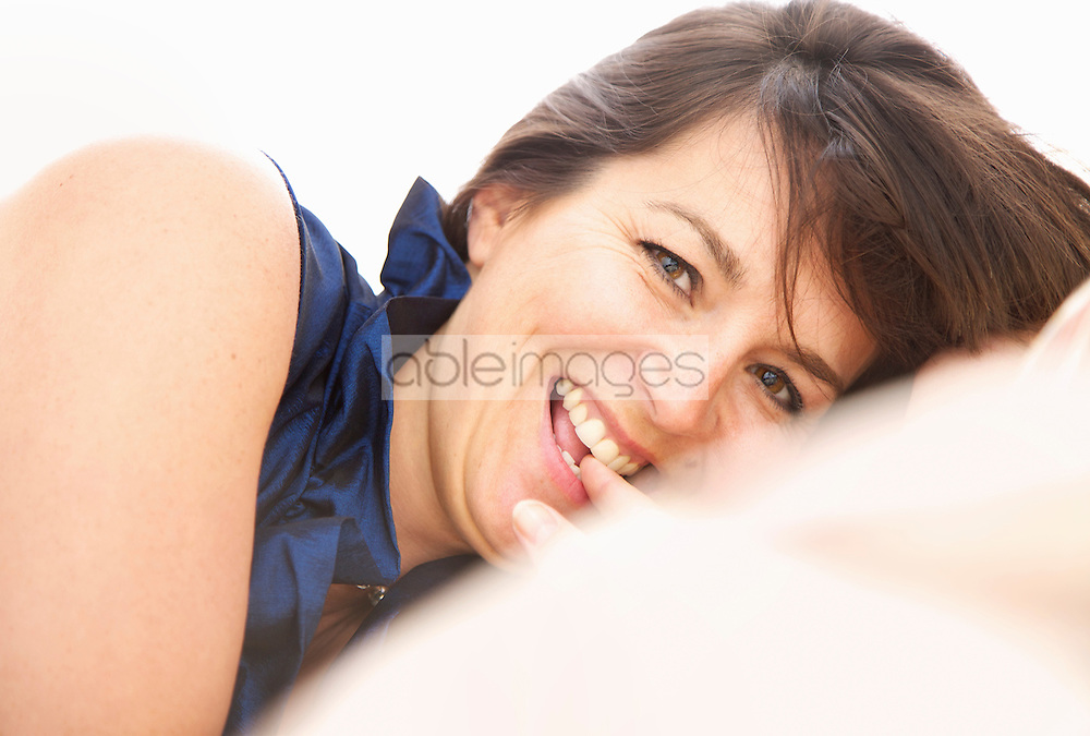 Smiling Woman Biting her Finger