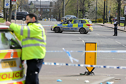 © Licensed to London News Pictures. 13/04/2019. London, UK. A crime scene on Bounds Green Road at the junction of Nightingale Road in North London, where a 19 years old man was stabbed just before 9.30pm on Friday 12 April 2019. The victim remains in a life threatening condition in a central London hospital. Photo credit: Dinendra Haria/LNP