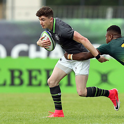 James McCarthy of Ireland is tackled by Wandisile Simelane of South Africa during the U20 World Championship match between Ireland and South Africa on June 3, 2018 in Narbonne, France. (Photo by Manuel Blondeau/Icon Sport)
