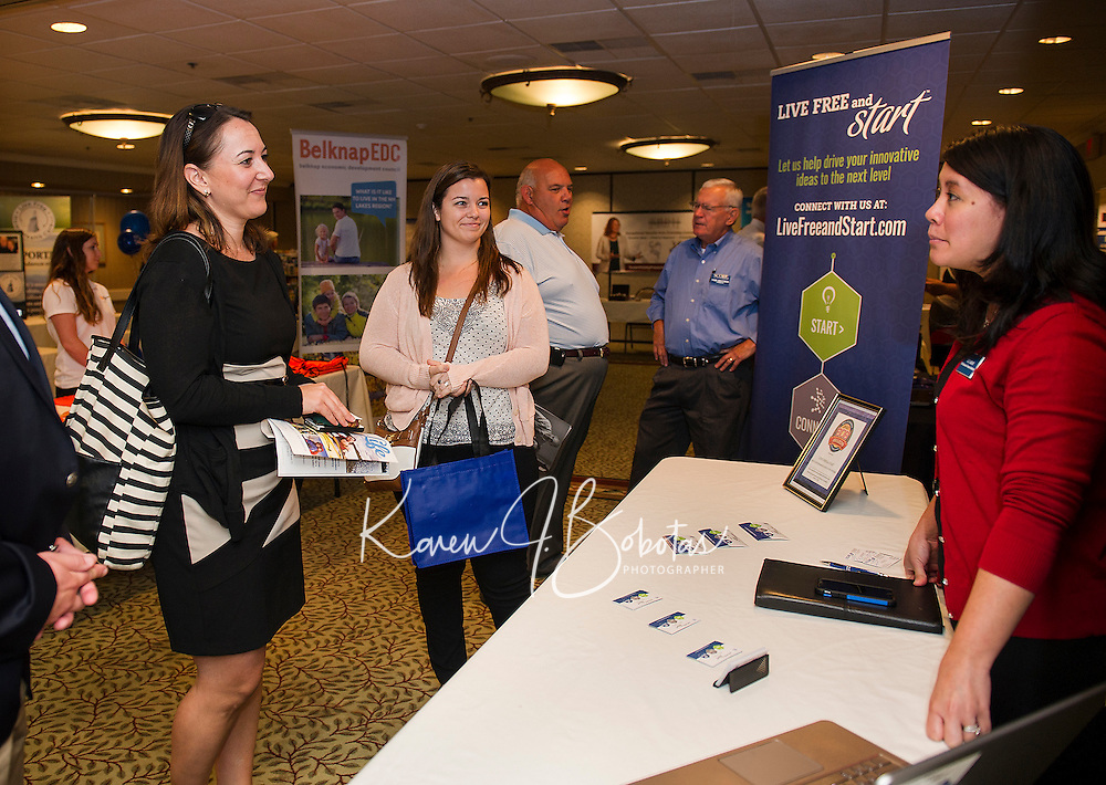 Justin Slattery Belknap EDC, Tina Kasim and Tara Buckley Division of Economic Development and Liz Gray NH Busines Finance Authority during the Lakes Region Business Resource Fair at the Margate on Wednesday morning.  (Karen Bobotas/for the Laconia Daily Sun)