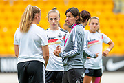 Bettina Weigmann (right), assistant coach of Germany discusses tactics with Lisa Ebert (left) and Sophia Kleinherne (centre)  before the UEFA Women's U19 Championship match between England Women and Germany at McDiarmid Stadium, Perth, Scotland on 16 July 2019.