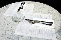 Café table with cutlery and menus