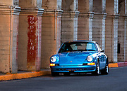 Image of a 1972 Metallic Blue Porsche 911 hot rod on the streets of Riverside, California, America west coast