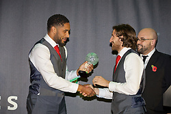 CARDIFF, WALES - Tuesday, November 8, 2016: Wales' captain Ashley Williams presents team-mate Joe Allen with the Players' Player of the Year award during the FAW Awards Dinner at the Vale Resort. (Pic by David Rawcliffe/Propaganda)