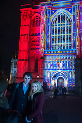 "© Licensed to London News Pictures. 14/01/2016. London, UK. Visitors enjoy ""The Light of the Spirit"" by Patrice Warrener projected onto Westminster Abbey.  The work forms part of Lumiere London, a major new light festival which commenced today to be held over four evenings and featuring artists who work with light.  The event is produced by Artichoke and supported by the Mayor of London.  Photo credit : Stephen Chung/LNP"