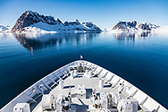 The bow of the National Geographic Orion cuts through the icy waters of Hornsund, Svalbard.
