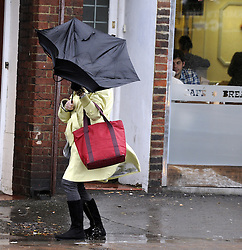 © Licensed to London News Pictures. 03/01/2012. Windy weather in  South East London.An elderly woman trying to hold onto her umbrella in Pettswood High Street. The Met Office has issued a severe weather warning as heavy rain and 85mph winds battered Britain..Photo credit : Grant Falvey/LNP