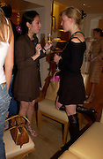 Edwina Khoo and Chiara Hunt , Burberry party to launch collection in  support of Breakthrough Breast Cancer. New Bond St. shop. Londddon. 5 October 22004. ONE TIME USE ONLY - DO NOT ARCHIVE  © Copyright Photograph by Dafydd Jones 66 Stockwell Park Rd. London SW9 0DA Tel 020 7733 0108 www.dafjones.com