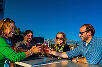 "Friends having drinks on the rooftop patio of ""Bailey's on the Beach"", Nob Hill, Albuquerque, New Mexico USA"