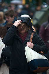 Christmas Storm Weather. Christmas shoppers struggle with heavy rain and strong wind on Oxford Street. Oxford Street London, United Kingdom. Monday, 23rd December 2013. Picture by Peter Kollanyi / i-Images