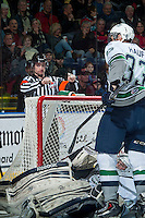 KELOWNA, CANADA - MARCH 18: Referee Ryan Benbow makes a call behind the net on March 18, 2015 at Prospera Place in Kelowna, British Columbia, Canada.  (Photo by Marissa Baecker/Shoot the Breeze)  *** Local Caption *** Ryan Benbow;