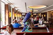 Macaw ornament in Cafe-Bistro at Dallmayr food store in Munich in Bavaria, Germany
