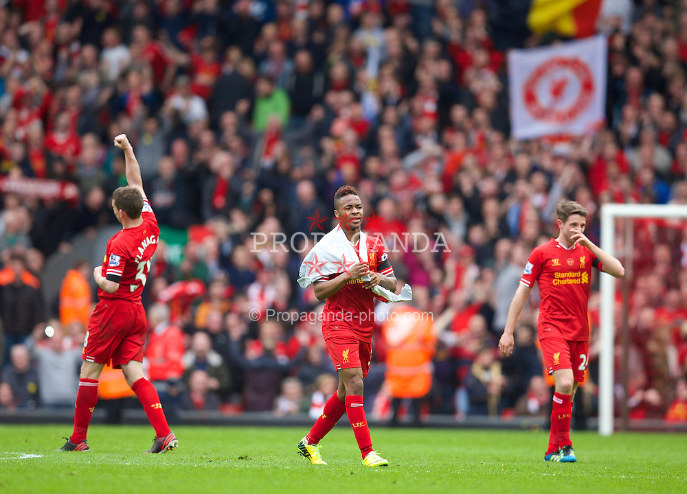 LIVERPOOL, ENGLAND - Sunday, April 13, 2014: Liverpool Raheem Sterling celebrates his side's 3-2 victory over Manchester City during the Premiership match at Anfield. (Pic by David Rawcliffe/Propaganda)