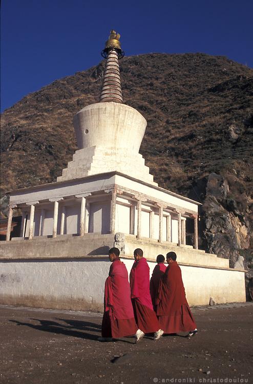 The white stupas dominate the landscape. On the pilgrims route..LAMBRANG MONASTERY IN XIAHE - CHINA.copyright: Androniki Christodoulou.