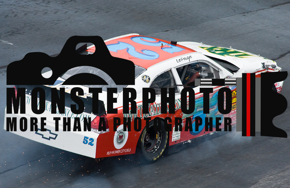 Kevin Lepage #52 crashes his car into the wall on the twentieth lap ...