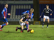 30th January 2018, Tulloch Caledonian Stadium, Inverness, Scotland; Scottish Cup 4th round replay, Inverness Caledonian Thistle versus Dundee; Inverness Caledonian Thistle's Coll Donaldson brings down Dundee's A-Jay Leitch-Smith