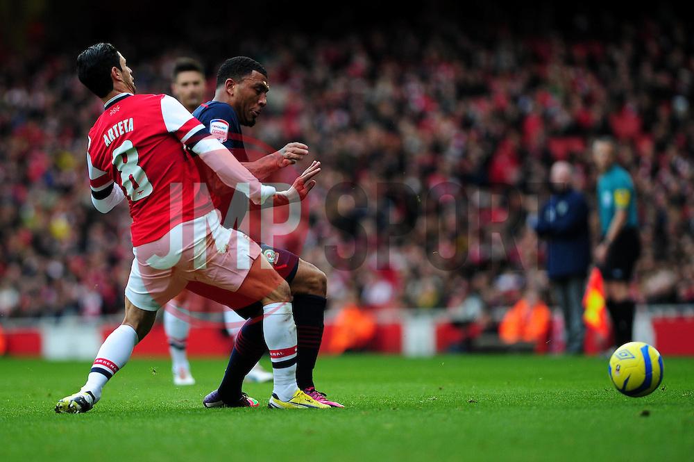 Arsenal's Mikel Arteta attempts to intercept the pass  to Blackburn Rovers' Colin Kazim-Richards - Photo mandatory by-line: Dougie Allward/JMP - Tel: Mobile: 07966 386802 16/02/2013 - SPORT - FOOTBALL - Emirates Stadium - London -  Arsenal V Blackburn Rovers - FA Cup - Fifth Round