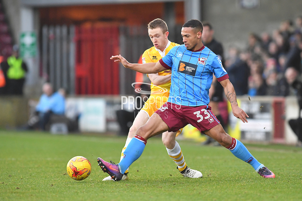 Scunthorpe United defender Jordan Clarke (33) and Shane Ferguson (18) Millwall FC midfielder during the EFL Sky Bet League 1 match between Scunthorpe United and Millwall at Glanford Park, Scunthorpe, England on 17 December 2016. Photo by Ian Lyall.