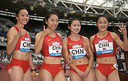 Jul 20, 2019; London, United Kingdom; Members of the China women's 4 x 100m relay pose after placing third in 42.71 during the London Anniversary Games at London Stadium at  Queen Elizabeth Olympic Park. Team members include Xiaojing Liang, Menqi Ge, Yongli Wei and  Lingwei Kong.
