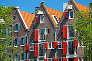 Canalside gabled houses - Dutch gables - and red painted shutters on Brouwersgracht in Amsterdam, Holland