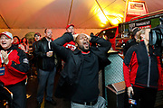Kansas City Corporate Event and Marketing Photographer - Former NFL player, Dante Hall expresses shock watching the Ravens vs. Steelers game while tailgating at the Built Ford Tough Toughest Tailgate before heading into the Chiefs game at Arrowhead Stadium on Sunday, December 25, 2016, in Kansas City, MO. Photos by Colin E. Braley for Ford