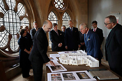The Prince of Wales is shown a model by exhibition designer Stuart McKnight (centre left), flanked by the Dean of Westminster John Hall (right) during his visit to the The Queen's Diamond Jubilee Galleries at Westminster Abbey in London.