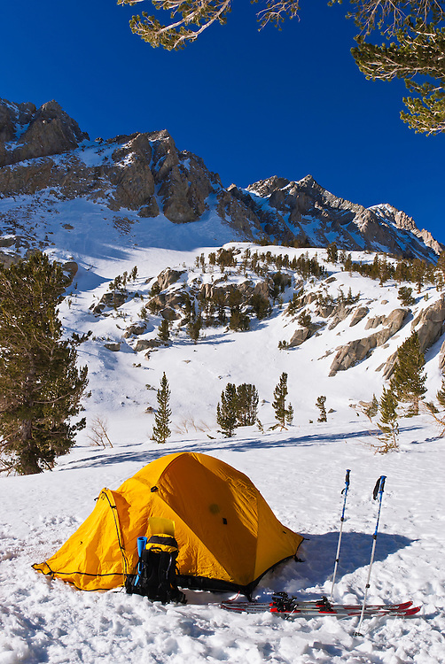 Yellow dome tent in winter under Piute Pass, Inyo National Forest, Sierra Nevada Mountains, California