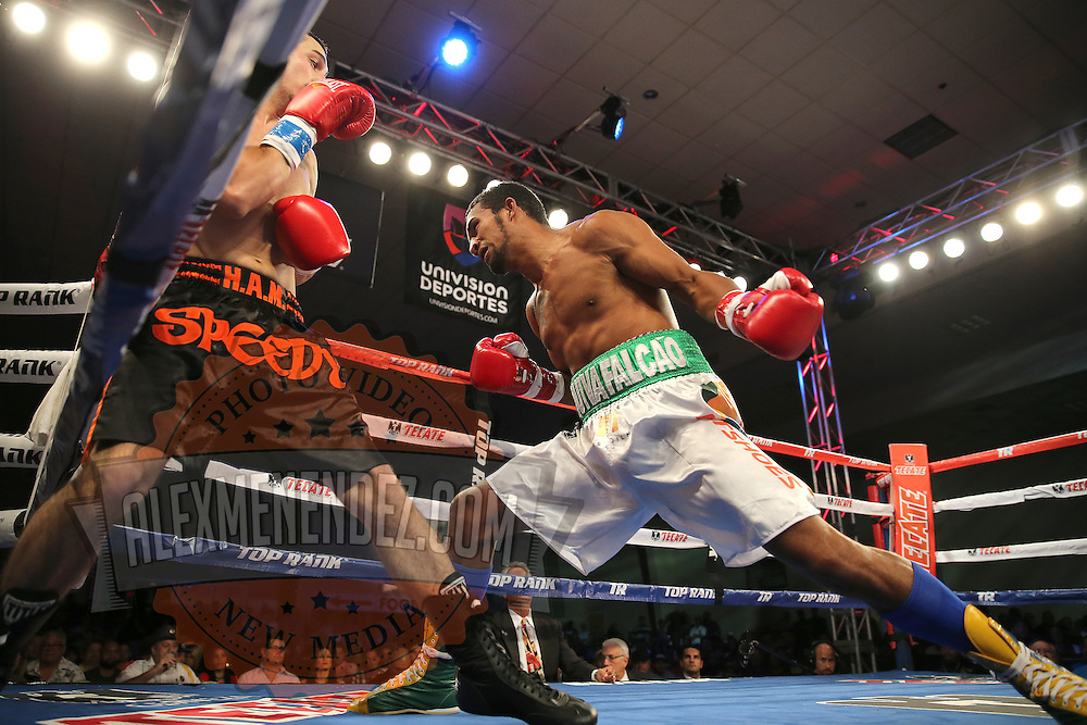 ORLANDO, FL - OCTOBER 04: Esquiva Falcao, 2012 Olympic silver medalist from Brazil (Right), punches Austin Marcum during a professional boxing match at the Bahía Shriners Auditorium & Events Center on October 4, 2014 in Orlando, Florida. (Photo by Alex Menendez/Getty Images) *** Local Caption *** Esquiva Falcao; Austin Marcum