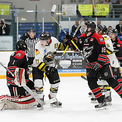 TRENTON, ON  - MAY 5,  2017: Canadian Junior Hockey League, Central Canadian Jr. &quot;A&quot; Championship. The Dudley Hewitt Cup. Game 7 between The Georgetown Raiders and The Powassan Voodoos. Parker Bowman #17 of the Powassan Voodoos and Matthew Thom #18 of the Georgetown Raiders battle for position during the first period <br /> (Photo by Amy Deroche / OJHL Images)