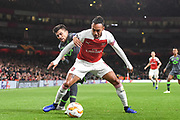 Arsenal Forward Pierre-Emerick Aubameyang (14) and Sporting Lisbon Forward Marcos Acuna (9) during the Europa League group stage match between Arsenal and Sporting Lisbon at the Emirates Stadium, London, England on 8 November 2018.