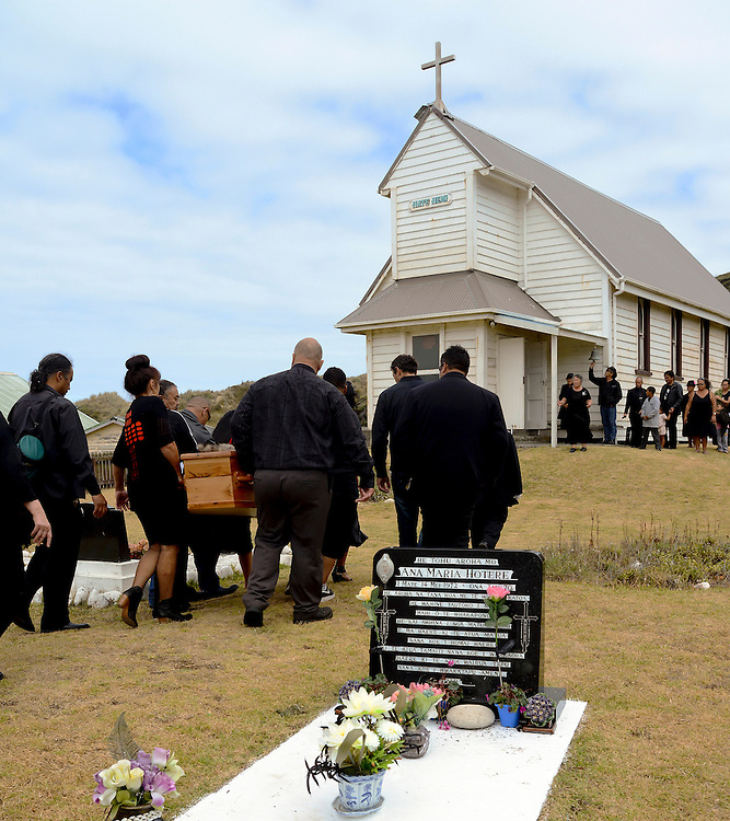 Mourners carry the casket of reknown artist Ralph Hotere from the meeting house on Matihetihe Marae past his mothers grave to the Catholic church at Mitimiti, North Hokianga, New Zealand, Monday March 04, 2013. Credit: SNPA / Malcolm Pullman