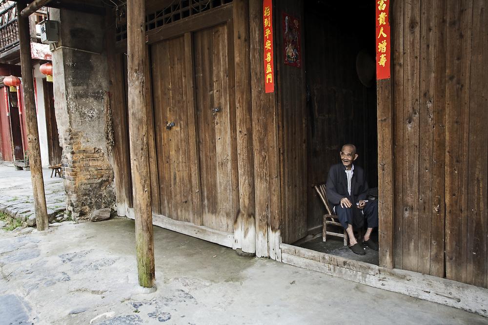 Old man at Daxu Ancient Village at Guangxi Province, China.
