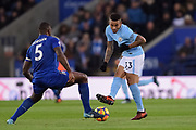 Leicester City defender Wes Morgan (5) blocks a pass by Manchester City striker Gabriel Jesus (33) during the Premier League match between Leicester City and Manchester City at the King Power Stadium, Leicester, England on 18 November 2017. Photo by Jon Hobley.