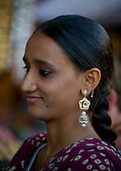 A young girl wearing elaborate earings in Jodhpur, Rajasthan, India