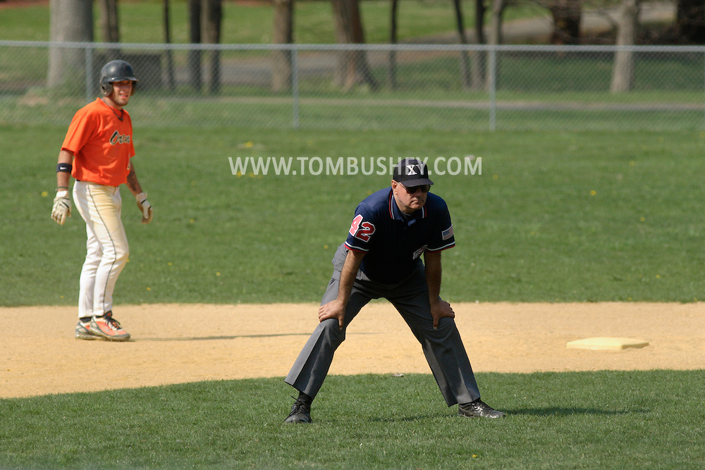 Middletown, NY - An umpire watches from the infield as SUNY Orange plays a Region XV baseball game against Dutchess Community College on April 26, 2008.