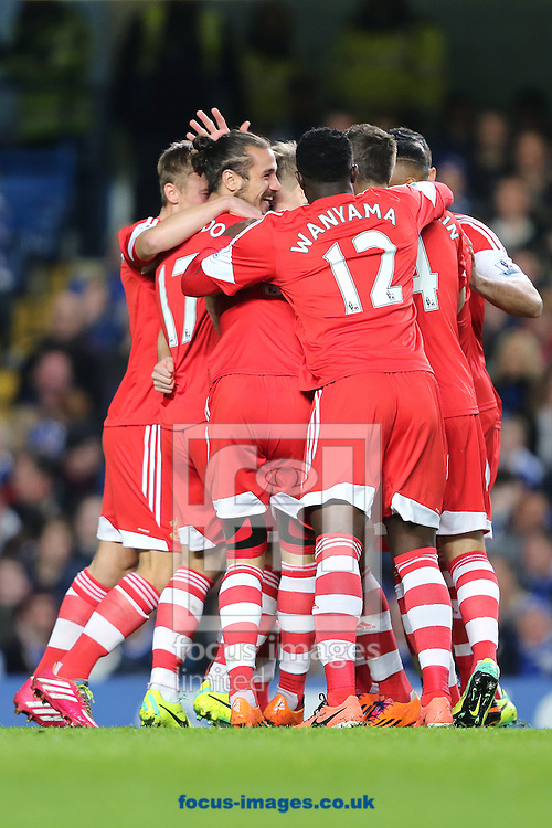 Picture by Richard Calver/Focus Images Ltd +447792 981244<br /> 01/12/2013<br /> Jay Rodriguez of Southampton (hidden) is mobbed by team mates after scoring the opening goal of the Barclays Premier League match against Chelsea at Stamford Bridge, London.