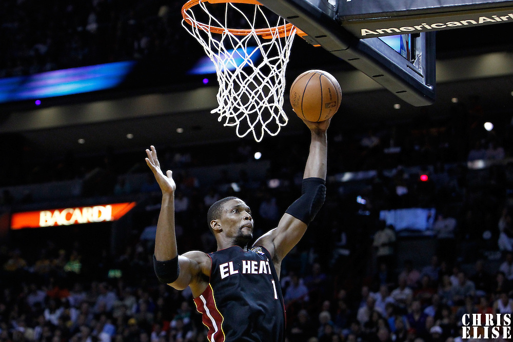 10 March 2011: Miami Heat power forward Chris Bosh (1) brings the defensive rebound during the Miami Heat 94-88 victory over the Los Angeles Lakers at the AmericanAirlines Arena, Miami, Florida, USA.
