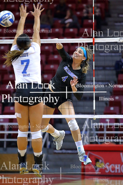23 November 2017:  Sarah Peterson strikes the ball past blocker Odessa Cody during a college women's volleyball match between the Drake Bulldogs and the Indiana State Sycamores in the Missouri Valley Conference Tournament at Redbird Arena in Normal IL (Photo by Alan Look)