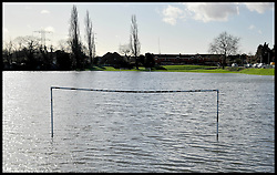A football pitch is flooded near flats in Woodford Green, London as floods hit London. Saturday, 1st February 2014. Picture by Andrew Parsons / i-Images