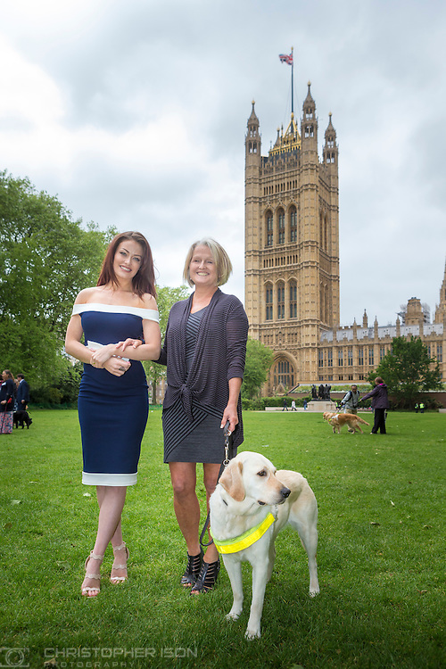 Star of Ex on the Beach, Jess Impiazzi and her guide dog owner mum Debbie with some of the over 100 guide dog owners and their dogs after they lobbied MPs at parliament to call for tougher penalties for taxi and minicab drivers who illegally turn them away.<br /> Picture date Wednesday 25th May, 2016.<br /> Picture by Christopher Ison for Guide Dogs<br /> For more information, contact Liz Marshall, Marketing Communications Manager on (0118) 983 8173 or  07500 823 758. email Liz.Marshall@guidedogs.org.uk