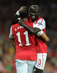 28.09.2011, Emirates Stadium, London, ENG, UEFA CL, Gruppe F, FC Arsenal (ENG) vs Olympiakos Piräus (GRE), im Bild Arsenal's Andre Santos is congratulated by team-mate Bacary Sagna after scoring his side's second goal // during the UEFA Champions League game, group F, ENG, UEFA CL, FC Arsenal (ENG) vs Olympiakos Piräus (GRE) at Emirates Stadium in London, United Kingdom on 2011/09/28. EXPA Pictures © 2011, PhotoCredit: EXPA/ Propaganda Photo/ Chris Brunskill +++++ ATTENTION - OUT OF ENGLAND/GBR+++++