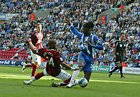 Photo: Sportsbeat Images.<br />Wigan Athletic v Fulham. The FA Barclays Premiership. 15/09/2007.<br />Wigan's Mario Melchiot, (R) is tripped in the area by Fulhams Hameur Bouazza