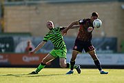Carl Winchester of Forest Green Rovers under pressure from Noor Husin of Stevenage during the EFL Sky Bet League 2 match between Forest Green Rovers and Stevenage at the New Lawn, Forest Green, United Kingdom on 21 September 2019.