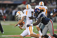 Ole Miss Rebels defensive end Fadol Brown (90) sacks Tennessee Volunteers quarterback Justin Worley (14) at Vaught-Hemingway Stadium in Oxford, Miss. on Saturday, October 18, 2014.