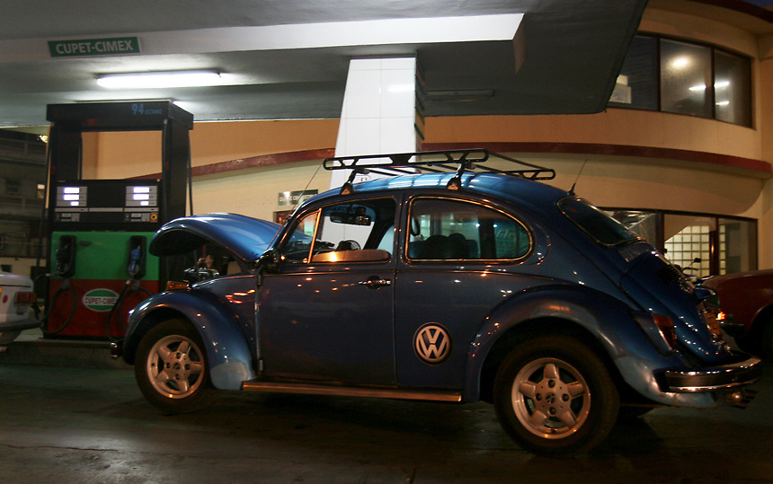 Volkswagen Beetle in gas station in Havana, Cuba..Photo/Angel Valentin
