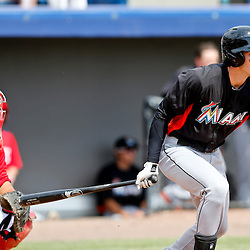 Mar 9, 2013; Melbourne, FL, USA; Miami Marlins left fielder Christian Yelich (76) hits a one run single scoring Gorkys Hernandez against the Washington Nationals during the top of the third inning of a spring training game at Space Coast Stadium. Mandatory Credit: Derick E. Hingle-USA TODAY Sports