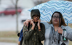 Cheyenne Harris, 15, a sophomore at Great Mills High School, and her mother, Jacqueline Harris, leave the James A. Forrest Career and Technology Center on Tuesday, March 20, 2018, after they were reunited. Great Mills students were evacuated after a suspected shooter was killed by a school resource officer. Two students were injured. Photo by Kim Hairston/Baltimore Sun/TNS/ABACAPRESS.COM