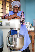 Joyce Marwa in her kitchen with her food mixer. <br /> <br /> Joyce set up and now runs a bakery that bakes bread and cakes. She also processes nutritious flour (a mix of 5 grains)<br /> <br /> She attended MKUBWA enterprise training run by the Tanzania Gatsby Trust in partnership with The Cherie Blair Foundation for Women.