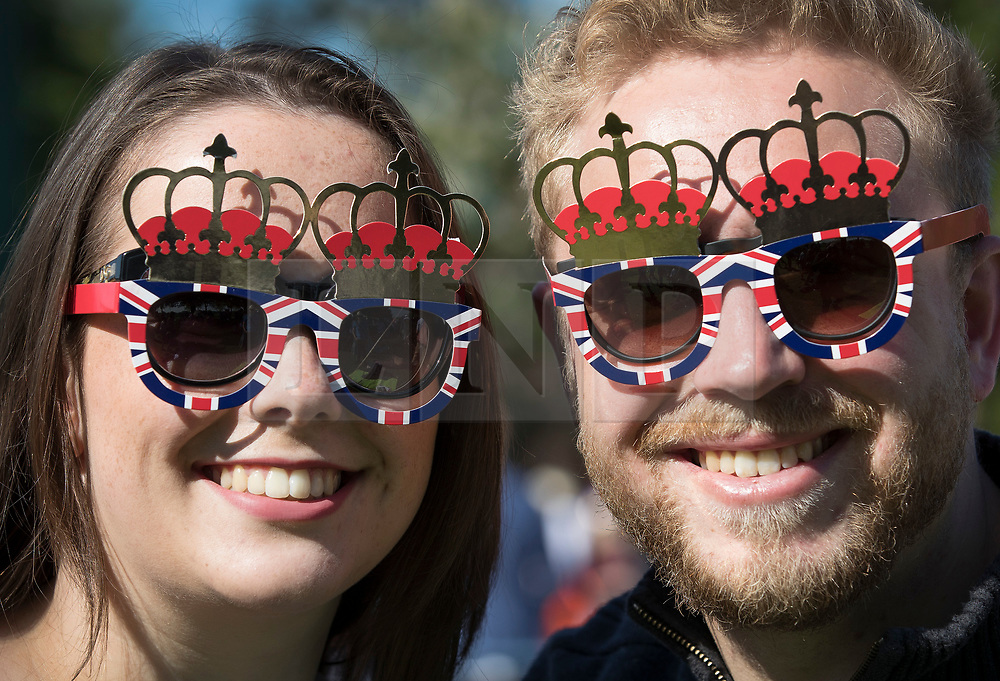 © Licensed to London News Pictures. 19/05/2018. Windsor, UK.  Royal fans Danni Clark (L) and Nick Rumsby gather on the Long Walk before the arrival of The Duke and Duchess of Sussex after the marriage ceremony at Windsor Castle. Photo credit: Peter Macdiarmid/LNP