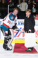 KELOWNA, CANADA - JANUARY 11:  Jordon Cooke #30 of the Kelowna Rockets accepts a star of the game award against the Tri City Americans at the Kelowna Rockets on January 11, 2013 at Prospera Place in Kelowna, British Columbia, Canada (Photo by Marissa Baecker/Shoot the Breeze) *** Local Caption ***